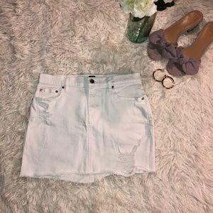 Short white denim skirt